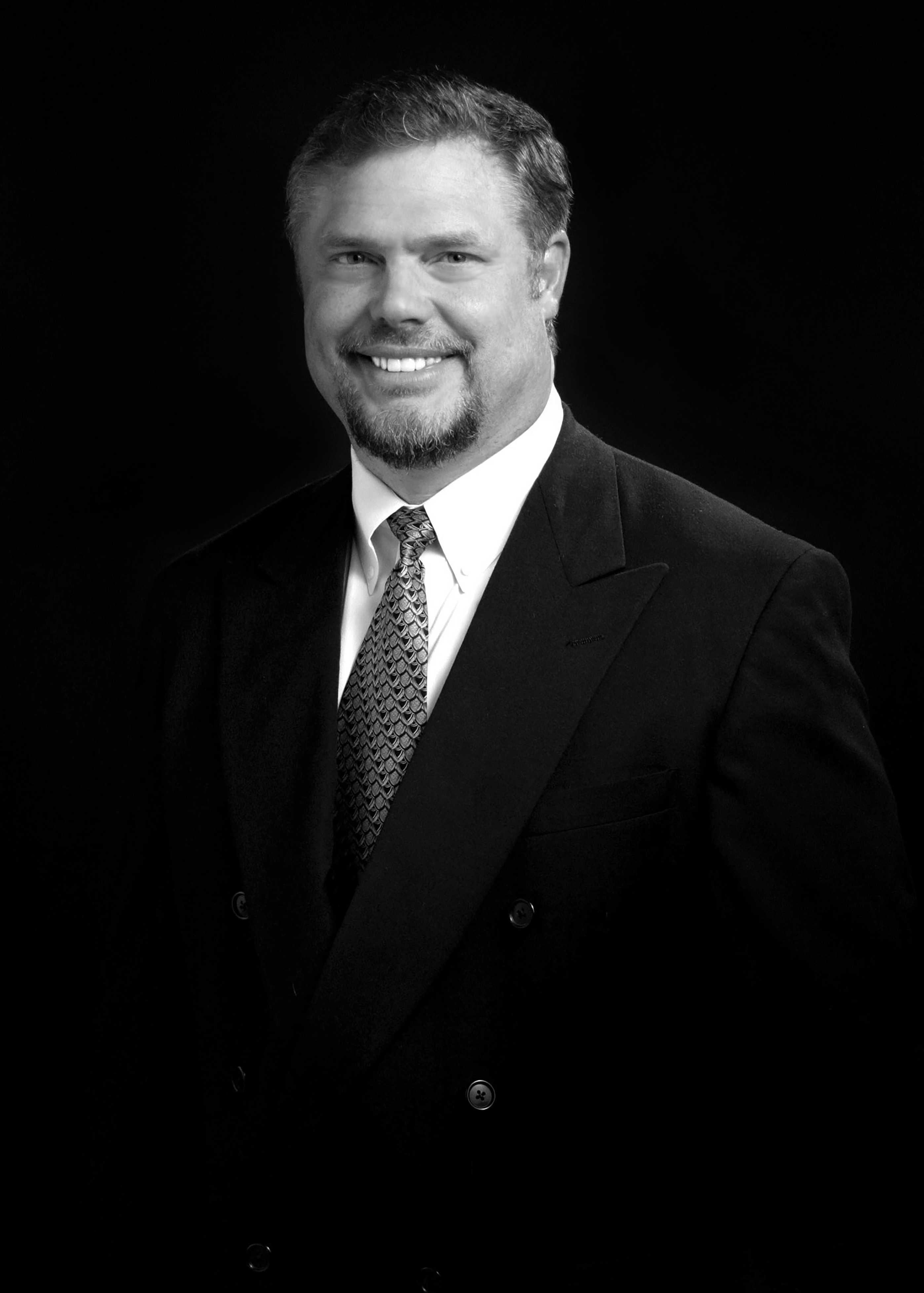 Headshot of Doctor James Craig Pinkerton