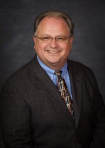 Headshot of DPM Thomas Wicks